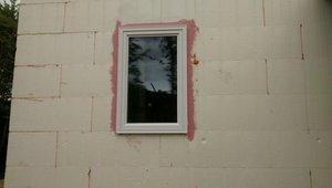 Before installing the triple-pane vinyl framed windows, the window rough openings are sealed with a liquid-applied flashing that provides a seamless moisture and air barrier to protect the wall from moisture intrusion.