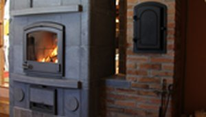 Masonry heater uses biomass for comfortable winter heat