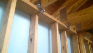 Metal straps tie the roof rafters to the top plate for additional resistance to severe storms.