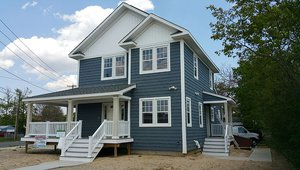 United Way built this 1,890-square-foot home in Deer Park, Long Island, New York, to the performance criteria of the DOE Zero Energy Ready Home (ZERH) program.