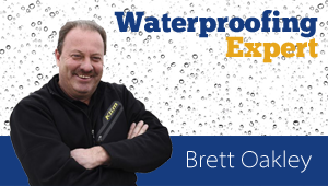Use a layered approach to waterproofing block foundations